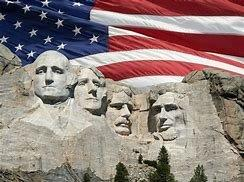 Rushmore with American flag